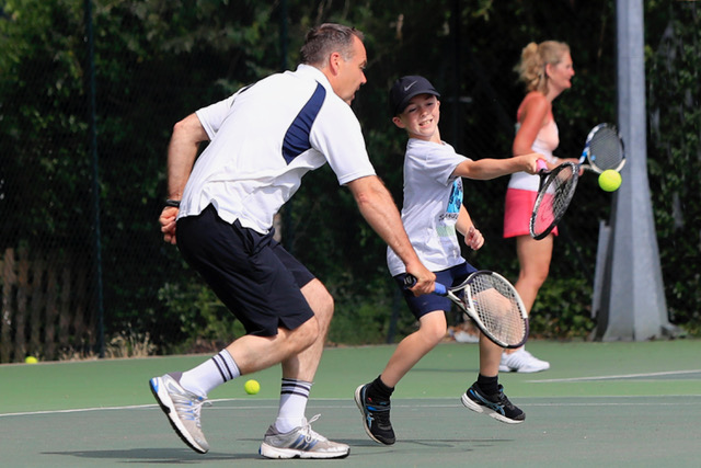 Playing tennis at Woodbridge Tennis Club