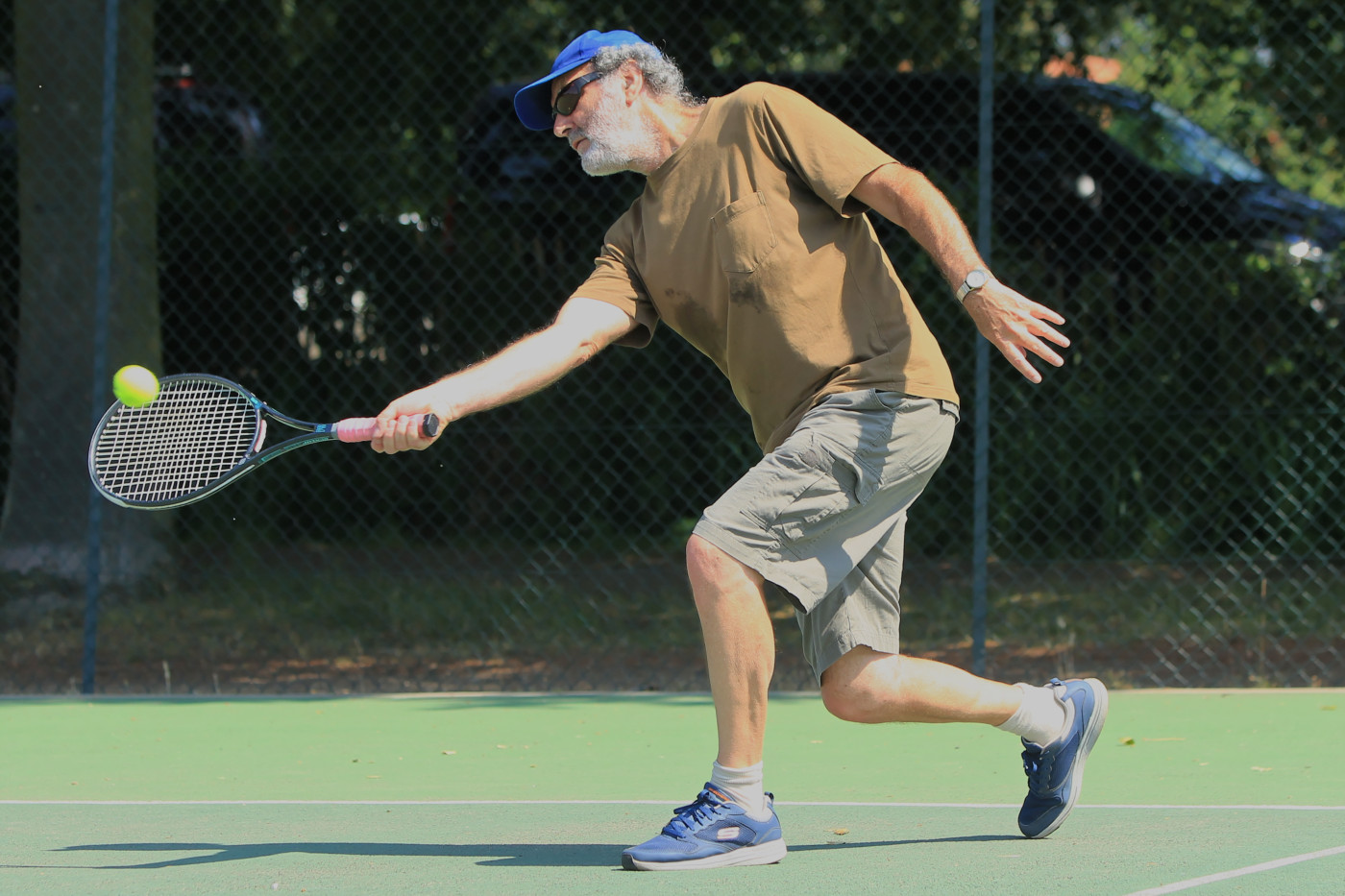A member of Woodbridge Tennis club on court