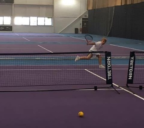Woodbridge Tennis Club junior player hits backhand