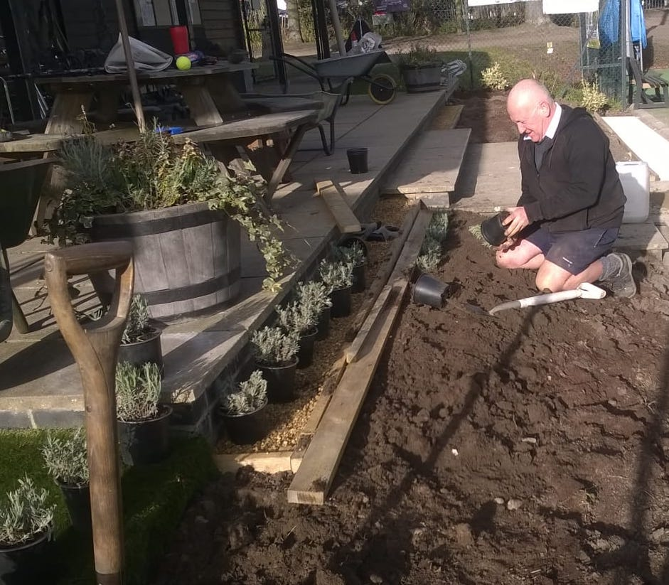 Woodbridge Tennis Club chairman Steve Lemon planting up the new garden