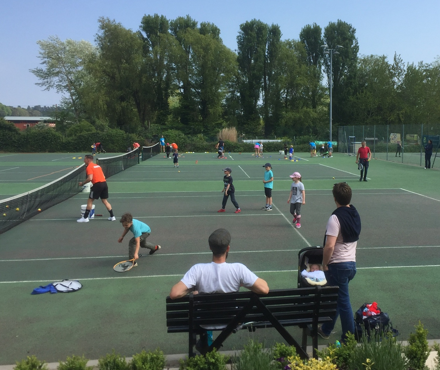 Watching the tennis players at Woodbridge Tennis Club in Suffolk