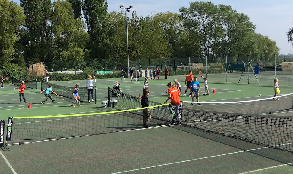 Players on court at the Big Tennis Weekend at Woodbridge Tennis Club in Suffolk