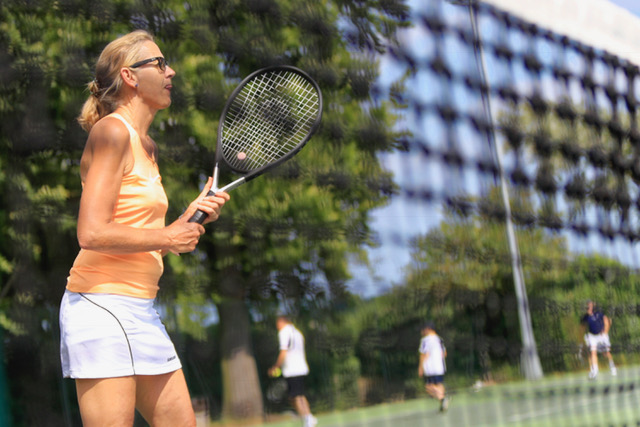 Playing tennis at Woodbridge Tennis Club in Suffolk