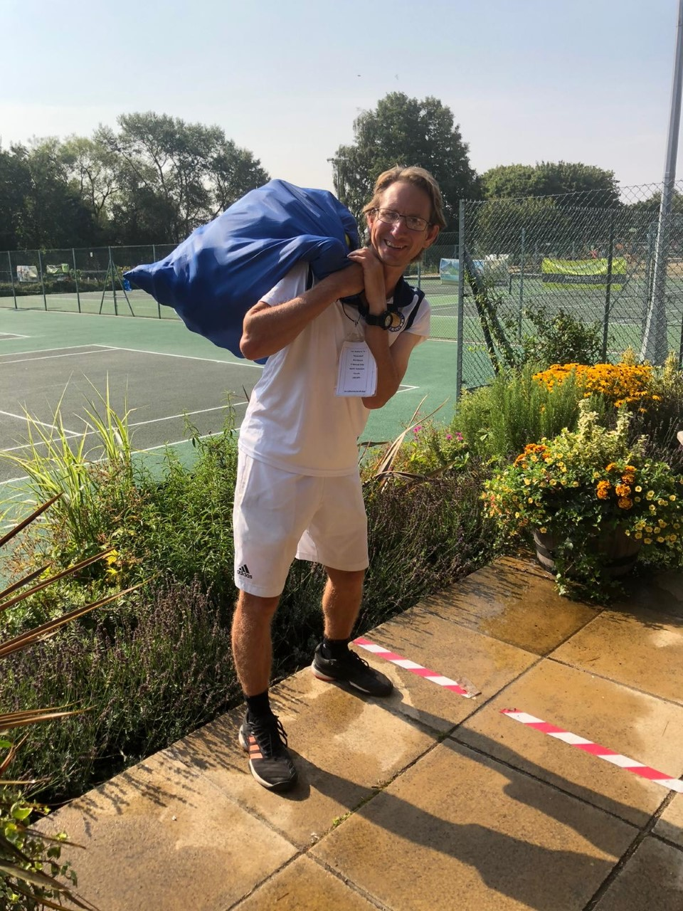 Woodbridge Tennis Club's Jon Mansfield and a sack of tennis balls headed to Recycaball